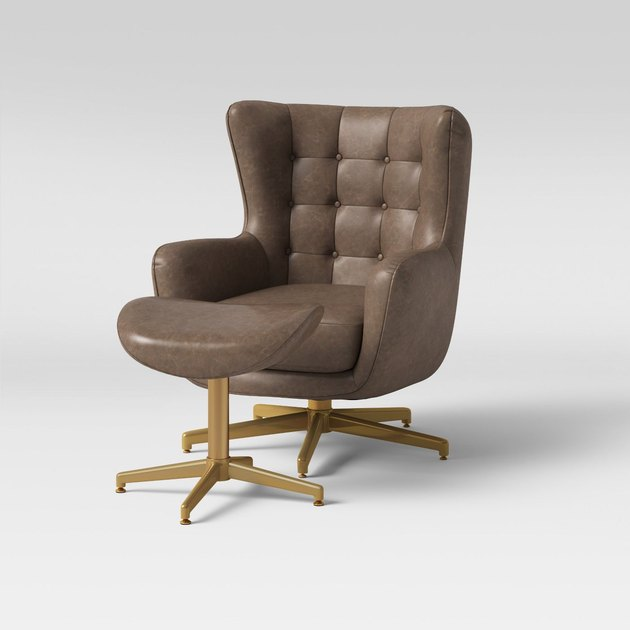 brown faux leather swivel chair and ottoman