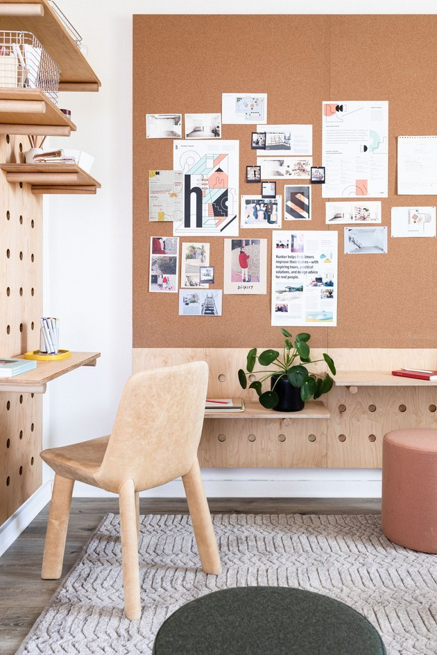 contemporary office space with custom-built pegboard wall unit