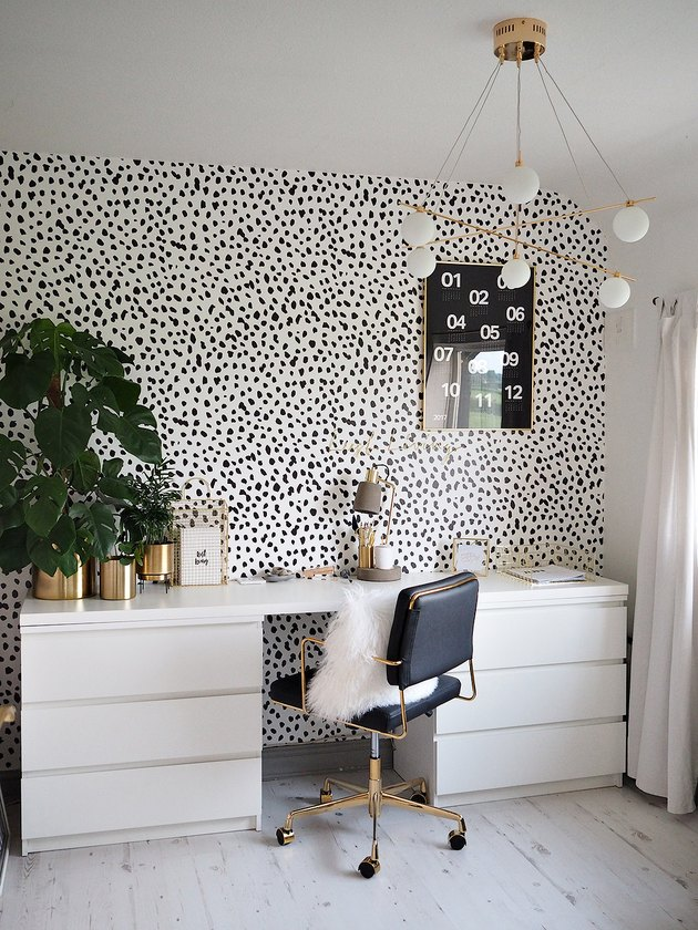 Contemporary office space with dalmation wallpaper and contemporary lighting