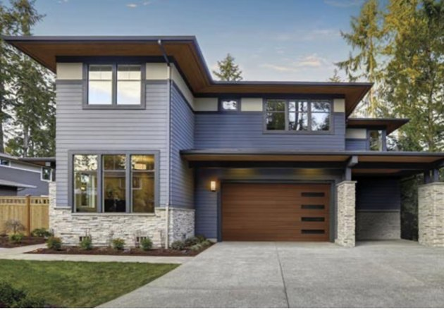 modern home with streamlined wooden garage door