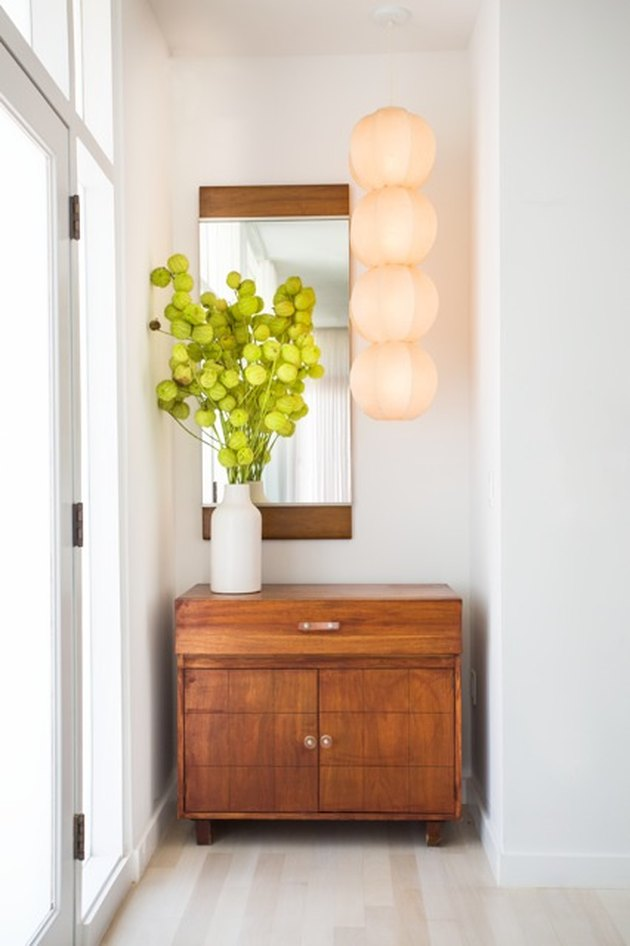 A California modern hallway loses a closet but gains a style statement.