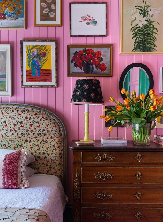 country bedroom idea with pink wooden panelling in eclectic bedroom