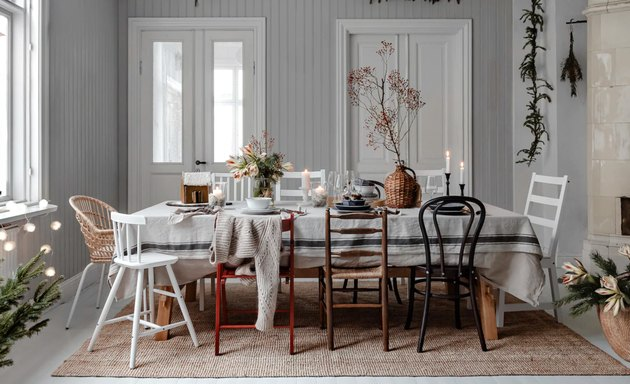 gray Christmas colors in dining room with table and holly berry and evergreen garland