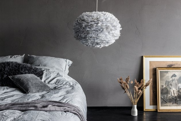 bedroom lighting idea with textured pendant next to bed