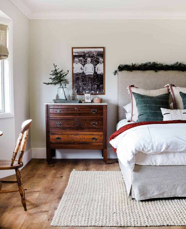 beige bedroom with bed with red and green Christmas colors