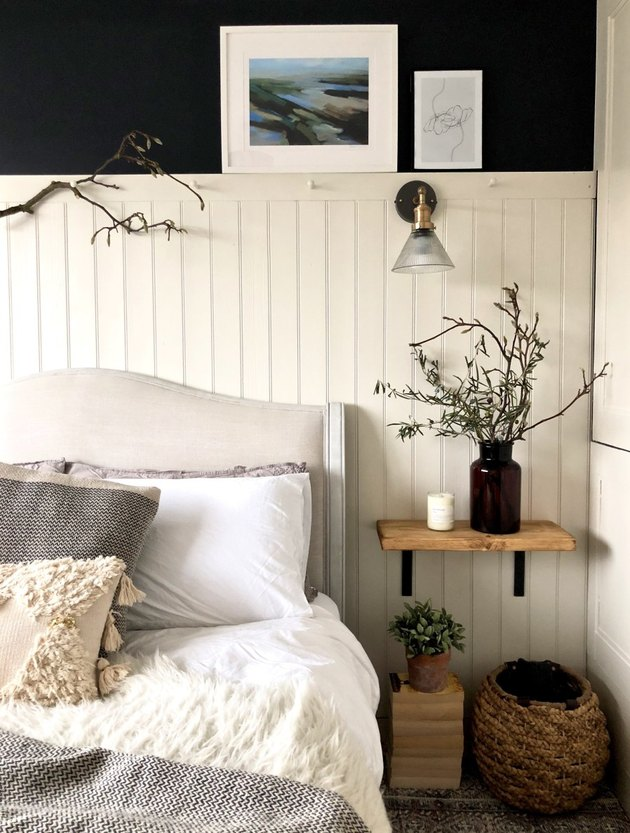 dark blue country bedroom idea with white tongue and groove wall panelling