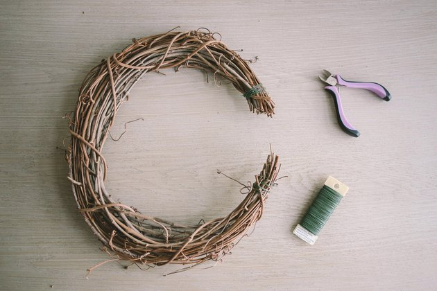 Ends of grapevine wreath tied with floral wire and shaped into crescent moon