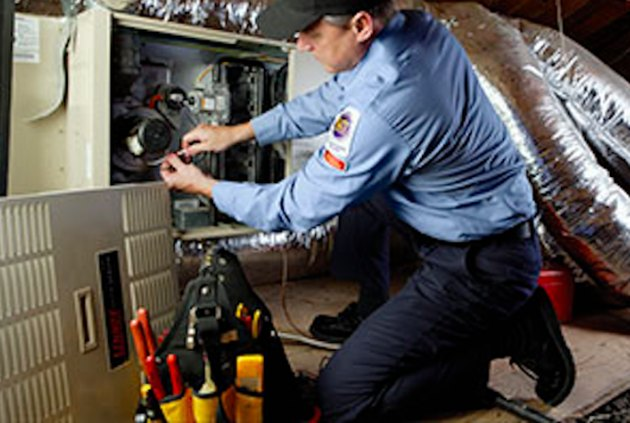 Tuning up a furnace.