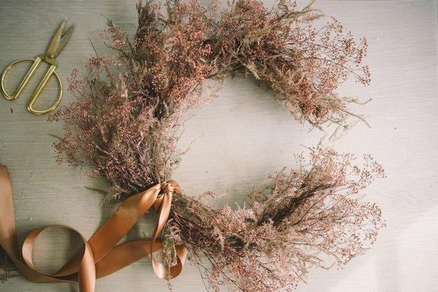 Satin ribbon tied around crescent moon wreath