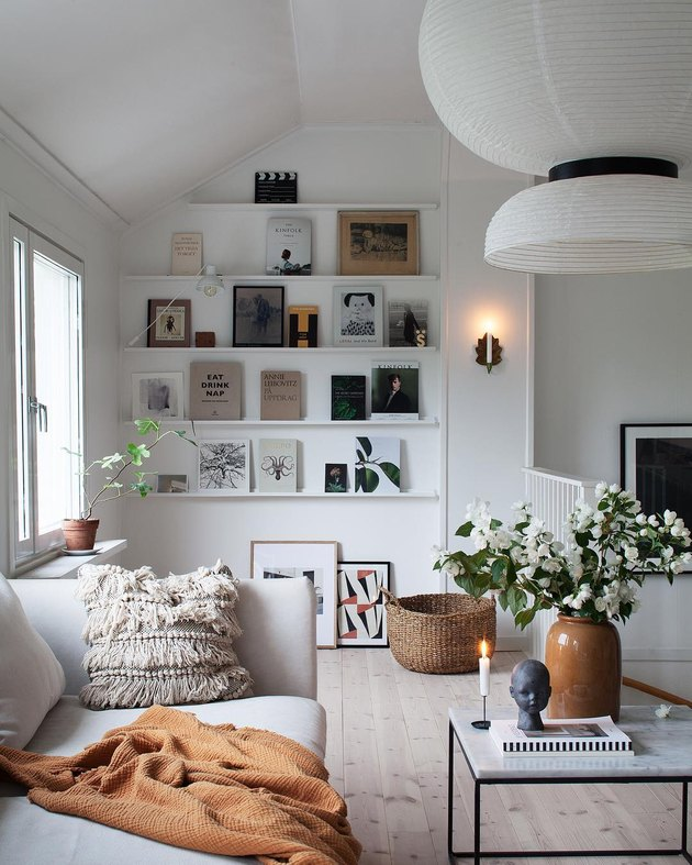 Scandinavian living room with open shelving and statement chandelier