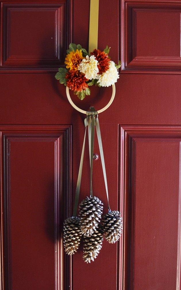 fall inspired DIY pine cone door knocker