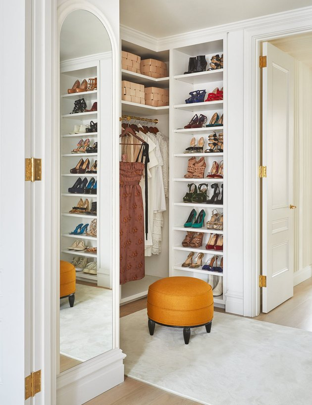bedroom closet idea with shelving for shoes and clothes hanging on rod with open shelving above