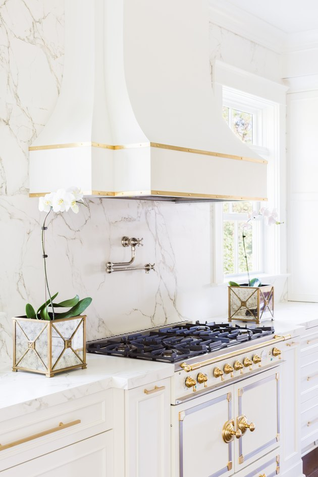 white kitchen idea with white appliances and white cabinets and marble backsplash
