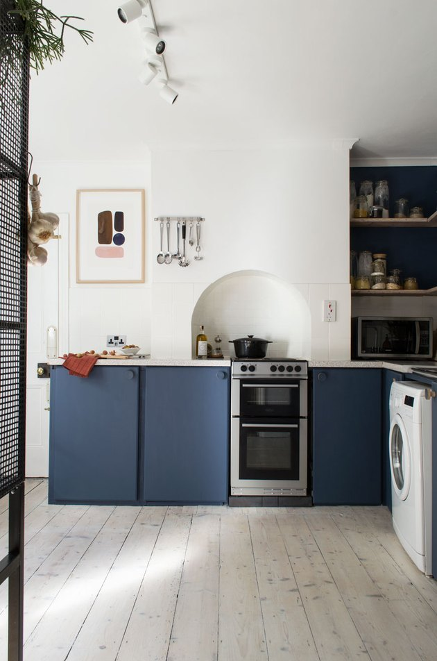 kitchen idea for small space with blue cabinets and laundry room included