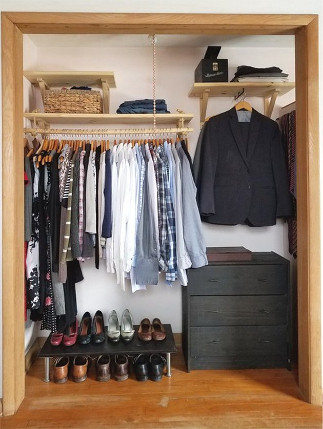 Open bedroom closet idea by Little Victorian with open shelving and hanging clothes
