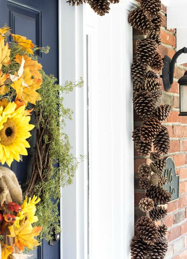 DIY fall-inspired pine cone garland for front door