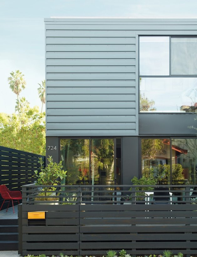 Contemporary home exterior in gray with modern deck