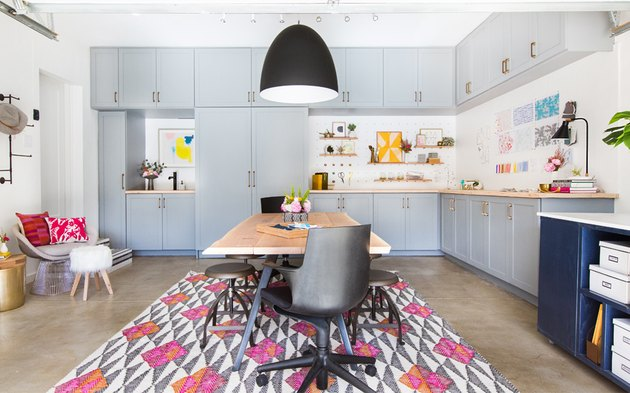 Garage office with colorful area rug and concrete floor