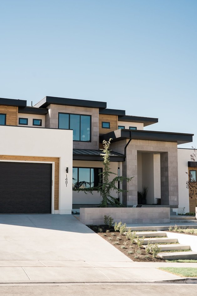 Contemporary home exterior with stonework and geometric details