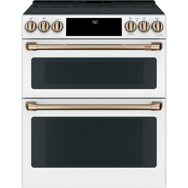 Double oven stove in white with brushed brass hardware