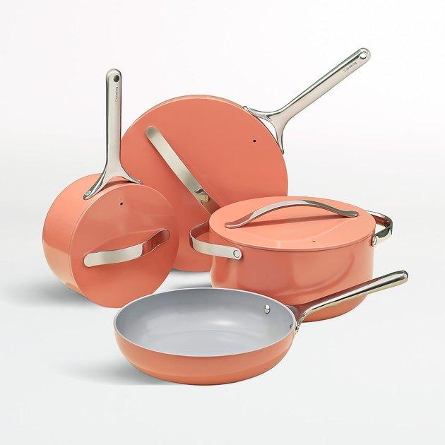 peach-colored ceramic pots and pans set