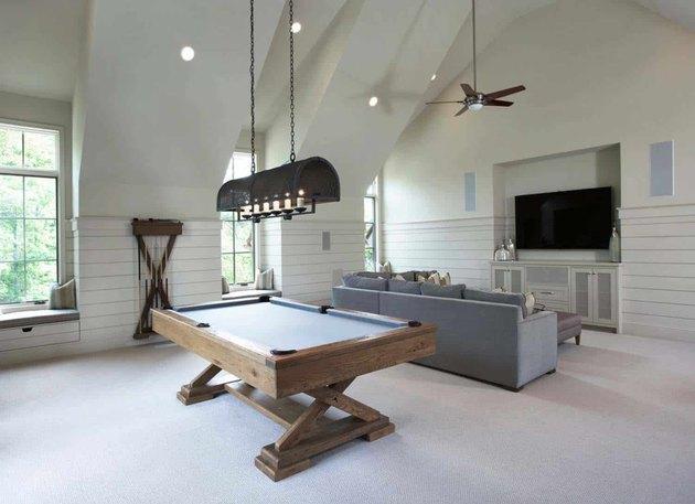sophisticated game room for bonus room above garage idea