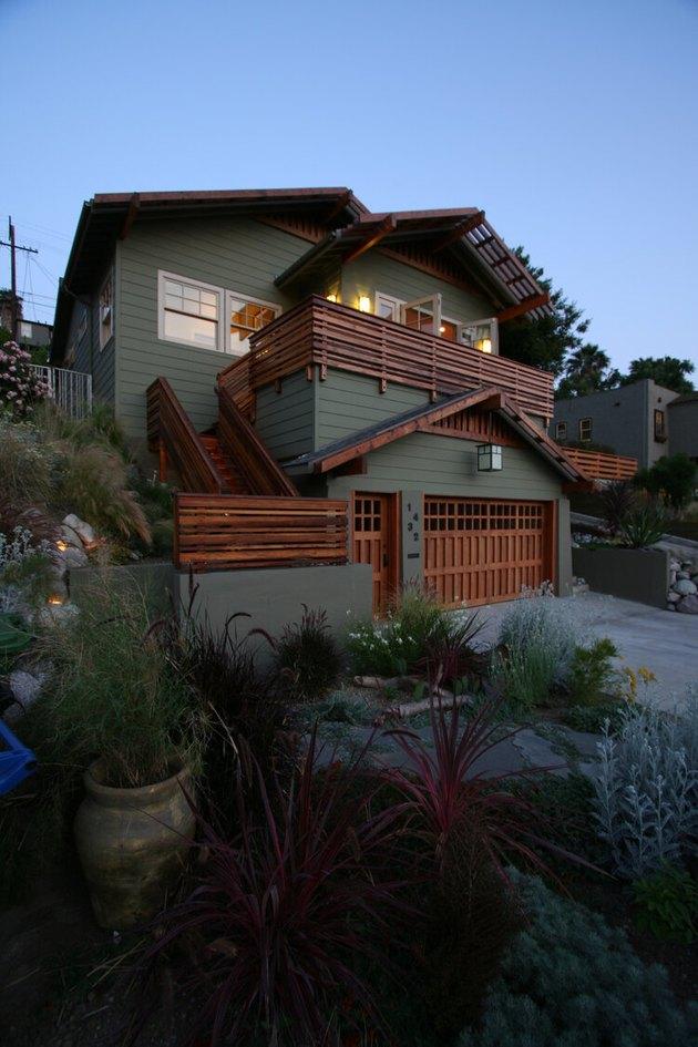 craftsman style garage door and green exterior