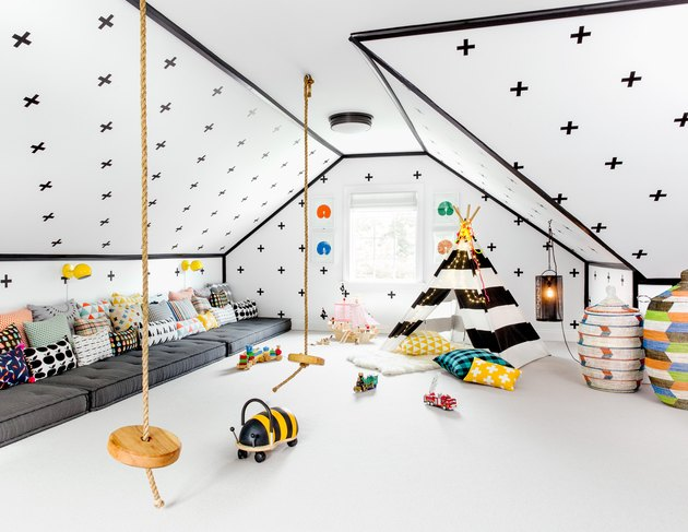 whimsical playroom with rope swings for bonus room above garage idea