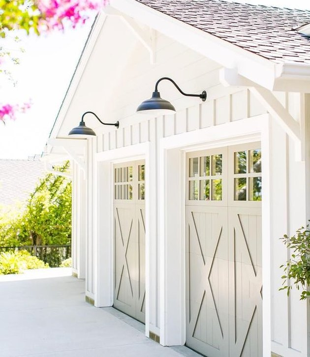 double set of craftsman style garage doors with farmhouse charm