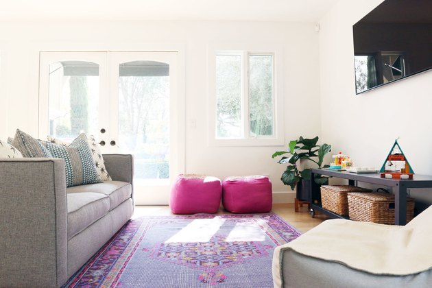 TV room with white walls and punchy accessories for bonus room above garage idea
