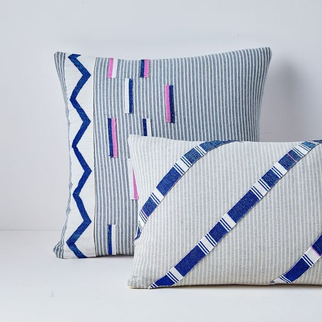 blue, white, and purple pillow covers