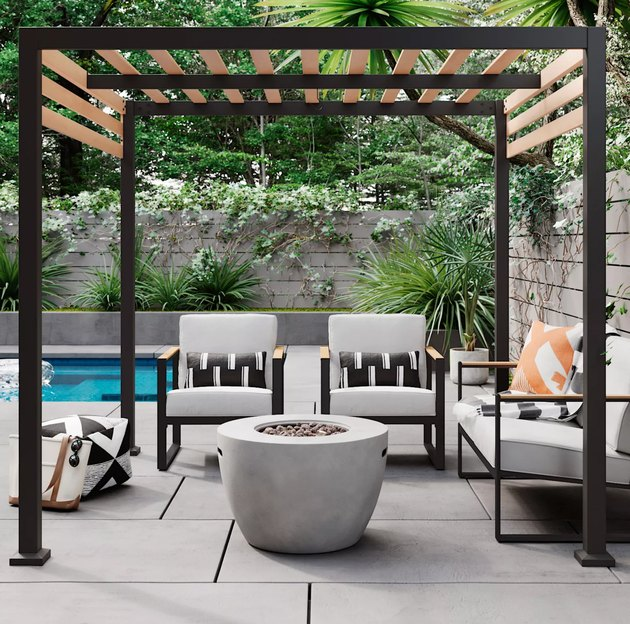 Black contemporary pergola next to pool with outdoor fireplace