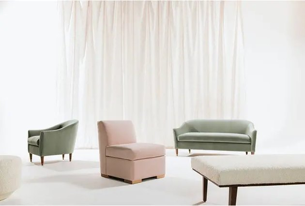 couches in various colors near white curtain