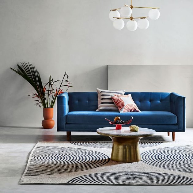 cream and black rug with blue couch