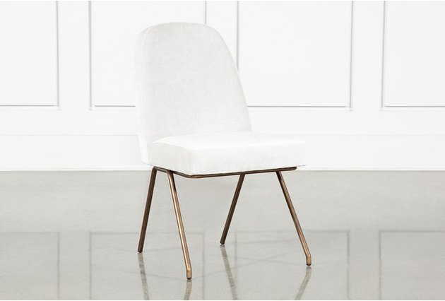 white chair with gold legs