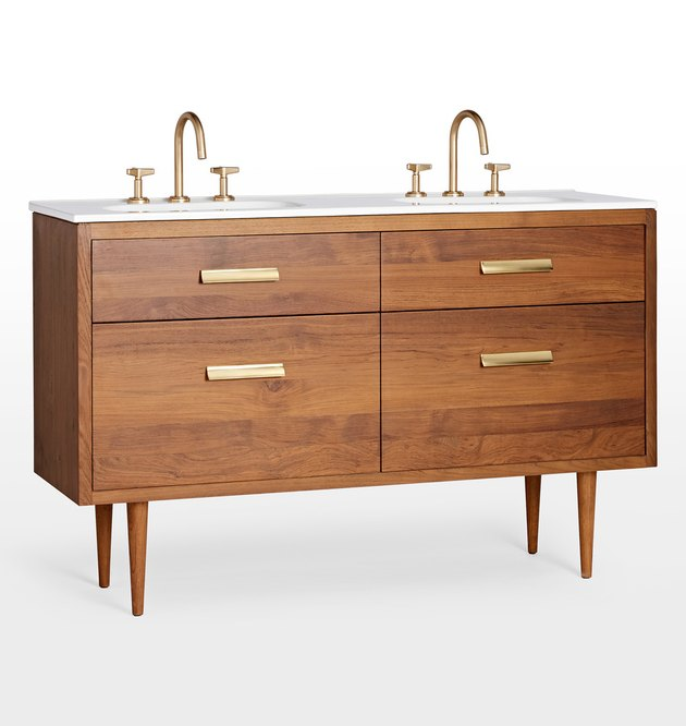 Wooden mid-century-inspired vanity in medium finish with two sinks and brass hardware