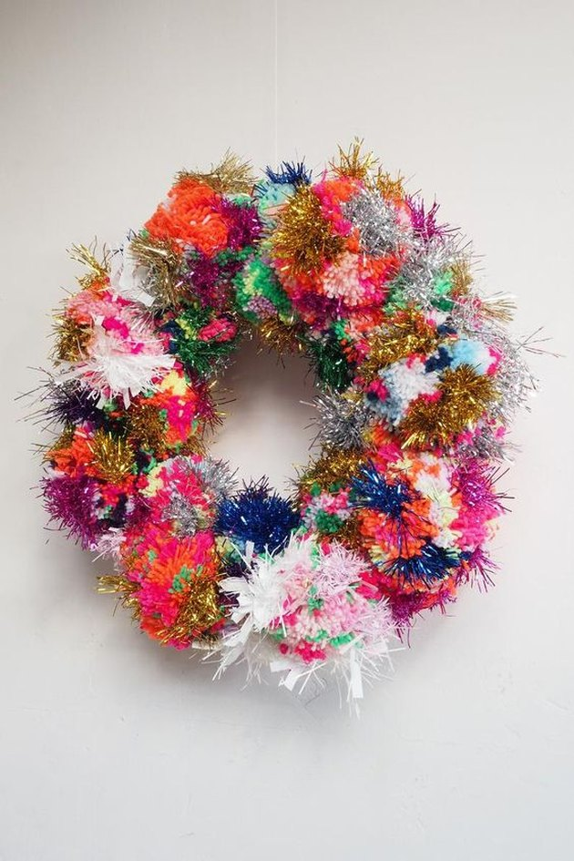 colorful pom pom wreath with tinsel for Christmas decorations list