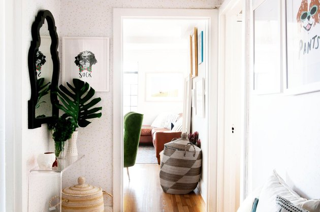 hallway with mirror and plants