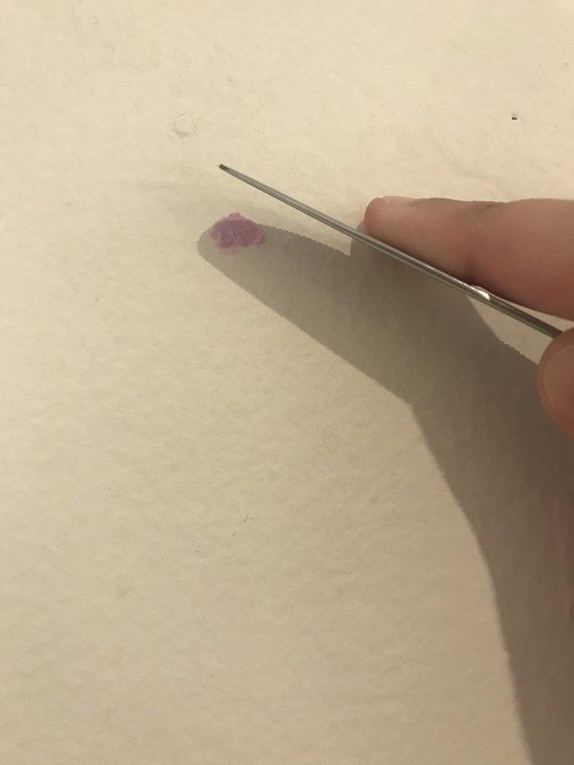 filling a nail hole