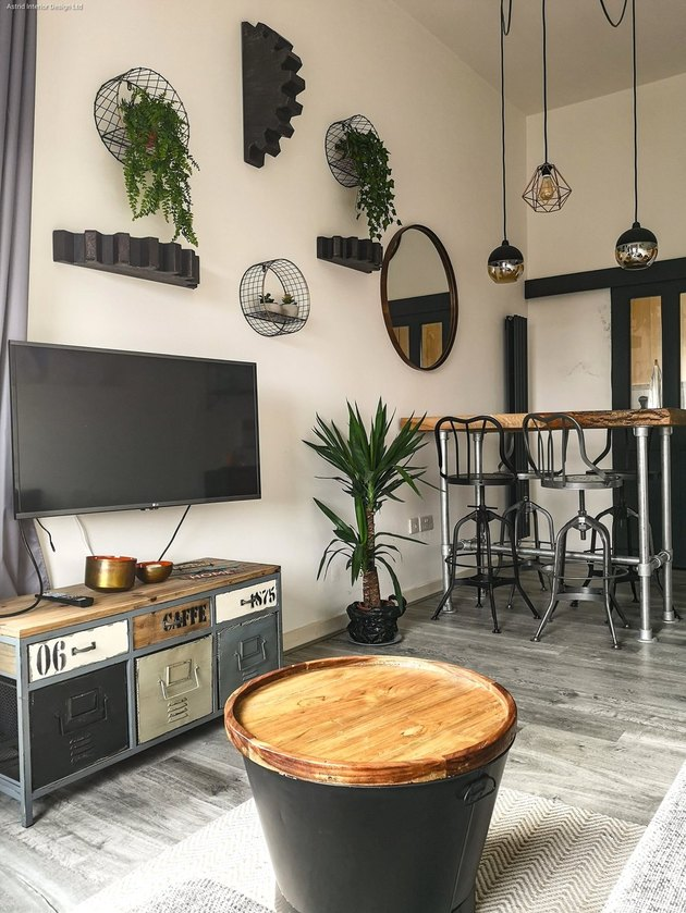 Industrial living room style with lofty ceiling and cage pendant lights