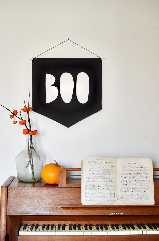 Black pendant that says Boo