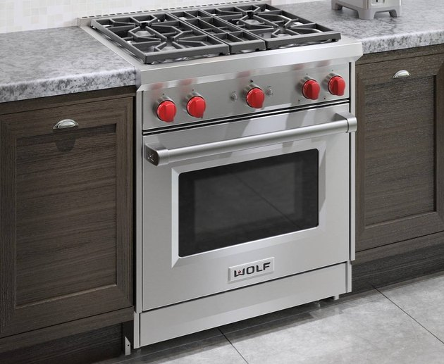 Slide-in Stainless Steel Gas Stove with red knobs