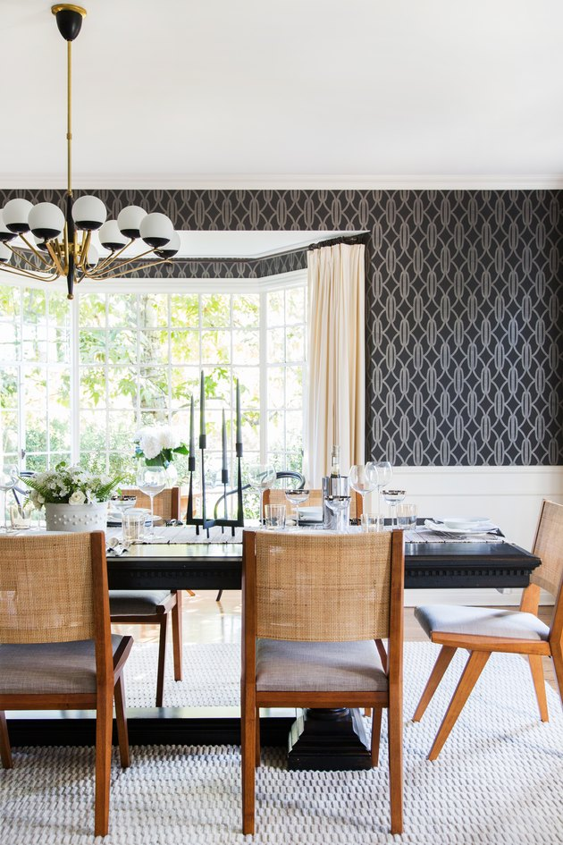 dining room with dark wallpaper and modern pendant