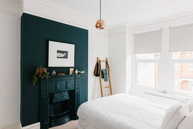 Bedroom with blue wall and fireplace
