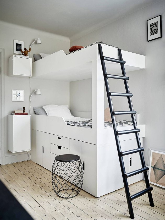 white bedroom with black accents and bunk beds