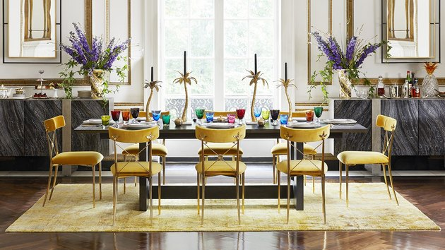 colorful traditional and modern dining room with yellow chairs