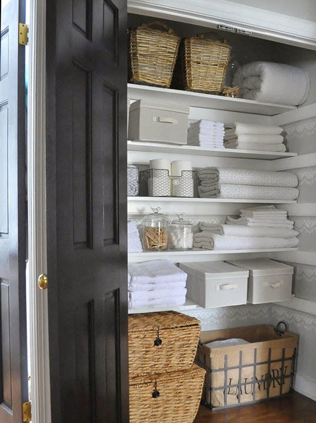 linen closet organization with open and closed containers and bins