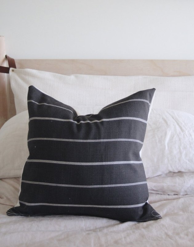 Charcoal square throw pillow with thin gray stripes