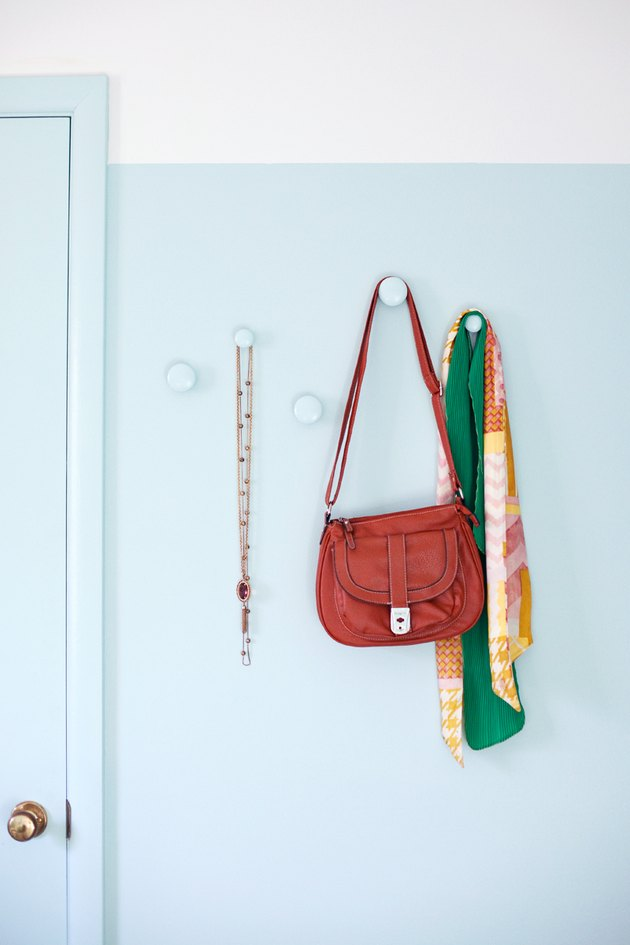 Purse hanging from a doorknob