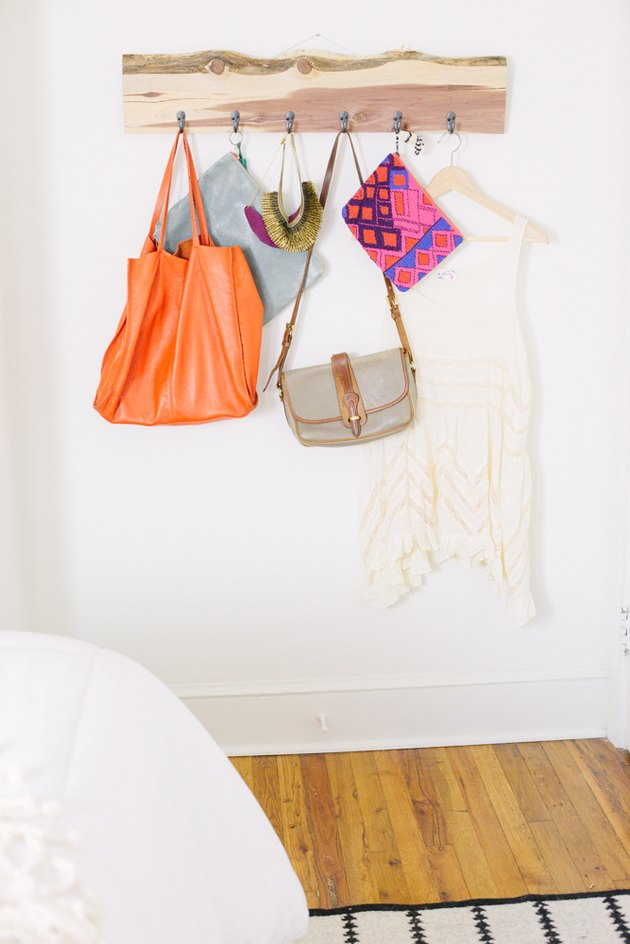 Purses hanging from upcycled wood